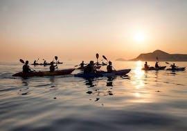 Some people kayaking during the Sunset Sea Kayaking to Lokrum Island in Dubrovnik with X-Adventure Seakayaking.