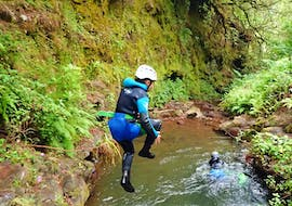 A young girl is jumping in a natural pool during the Canyoning for Beginners on Madeira organized by Epic Madeira.