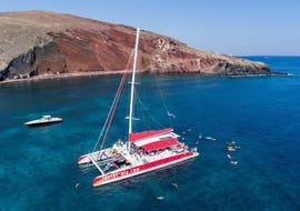 Catamaran Tour in Santorini to the Hot Springs and Red Beach with Sunset Oia