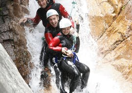 """During the Canyoning """"Discovery"""" - Canyon de Pulischellu, a group of friends is abseiling a canyon under the supervision of an experienced guide form Acqua et Natura."""