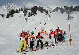 Children are taking some Kids ski lessons for advanced skiers with ski school Stuben.