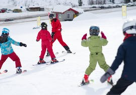 Children are learning the basics during the private ski lessons for kids of all levels with ski school Stuben.