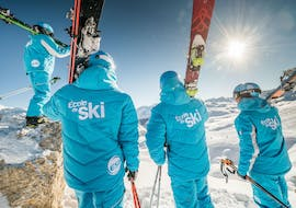 During a ski lesson for adults, skiers prepare to descend an off-piste run with 360 Avoriaz.