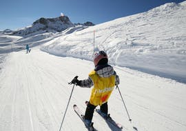 A kid progresses on a snow plough on a slope during a private ski lesson with 360 Avoriaz.