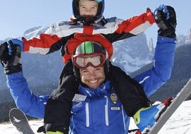 Kid and ski instructor playing in Andalo after one of the Kids Ski Lessons (4-5 y.) for Beginners - Baby Weekend.