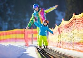 A kid is taking Private Ski Lessons for Kids - Holiday - Villaroger with Evolution 2 Spirit - Arc 1950 & Villaroger.