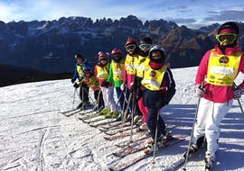 Kids posing for a picture in Andalo during one of the Kids Ski Lessons (6-14 y.) for Beginners.