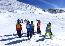 """Kids and ski instructor in the mountains in Andalo during one of the Kids Ski Lessons """"Elite"""" (6-14 y.) for Beginners."""