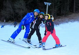 Kids with ski instructor taking a picture in Andalo after one of the private Ski Lessons for Kids of All Levels.