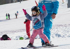 A little girl has just successfully completed her first snow plough during her private ski lesson with 360 Avoriaz.
