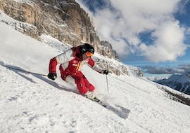 A ski instructor from Carezza Skischool is leading the way during Ski Lessons for Adults - Advanced.
