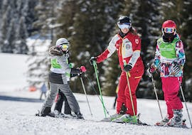 Siblings are improving their skiing technique during Private Ski Lessons for Kids - All Levels with Carezza Skischool.