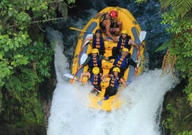 The participants of Rafting on Kaituna River in Okere Falls are plunging into the world's highest commercially rafted waterfall, Tutea Falls, with their experienced guides from Rotorua Rafting.