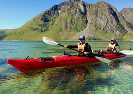 """Paddling through the crystal-clear water during Sea Kayak Tour """"Explore"""" in Lofoten with a guide from Northern Explorers."""