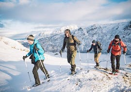 """A group of parlicipants during Snowshoeing Tour """"Northern Lights"""" in Lofoten organized by the local experts from Northern Explorer."""
