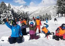 A snowboarding lesson for kids & adults of all levels with Escuela Española de Esqui y Snowboard de Cerler.