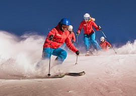 Skiers are enjoying their private ski lessons for adults of all levels with Top secret ski school in Davos Klosters.