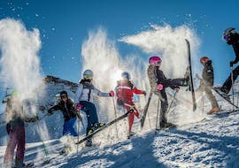 During the Kids Ski Lessons (6-14 years) - Advanced with Zermatters, a group of children is having fun in the snow.