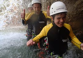 A boy is enjoying the time spent with his parents during the Canyoning for the whole Family organized by canyoning erleben.