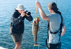 Our guests admiring their catch during our Fishing Boat Tour in Tromsø with Pukka Travels.