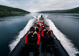 Our guests speeding on the Tromsø waters during the activity Arctic RIB High Speed Boat Tour in Tromsø with Pukka Travels