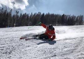 Private Ski Lessons for Adults - All Levels of the Italian Ski School School Scuola Italiana di Sci Civetta are helping this man to improve.