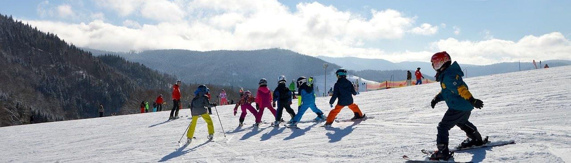 kids-ski-lessons-8-12-years-holiday-1st-timer-moonshot-hero
