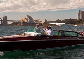 A couple is enjoying Private Luxury Boat Cruise in Sydney with Sightseeing on a hybrid electric charter vessel from Sydney Luxury Cruise.