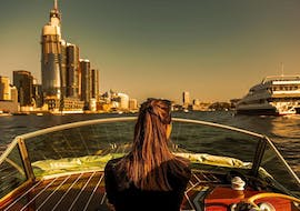 A woman is enjoying the views during the Private Luxury Boat Cruise in Sydney at Sunset organised by Sydney Luxury Cruise.