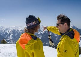 An instructor is teaching a student during her private ski lessons for adults of all levels with Wolfgang Pfeifhofer