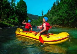 """Two participants of Rafting """"Mini Raft"""" - Savinja are paddling on the river with the guides from Funpark Menina."""