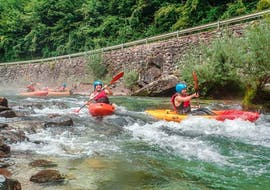"""A group oof kayaketrs is paddling on the river during Sit On Top Kayak Tour """"Classic"""" - Savinja organized by Funpark Menina."""