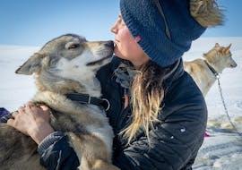 Cuddles with a husky after a Spring Husky Sledding in Geilo organized by Geilo Husky.
