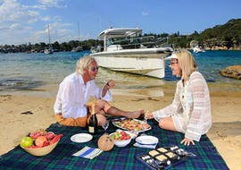 Two of our guests enjoying the Private Sydney Boat Tour with Beach Picnic with Sydney Harbour Boat Tours