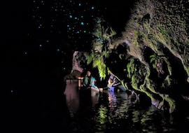 Two participants of the Kayak Rotorua - Twilight Glow Worm Tour Summer are starring in awe the glow worms during the activity organized by Paddle Board Rotorua.