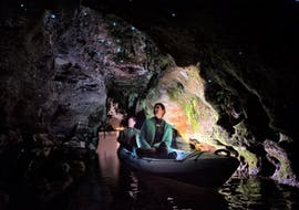 During the Kayak Rotorua - Twilight Glow Worm Tour Summer, two participants are admiring the magnificent glow worms during the activity organized by Paddle Board Rotorua.