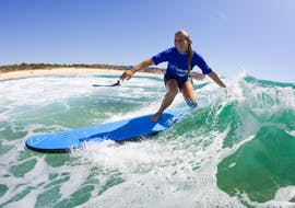 A woman is enjoying her first time on a surfboard during the Surfing Lessons in Maroubra for Teens & Adults - Beginner organised by Let's Go Surfing.