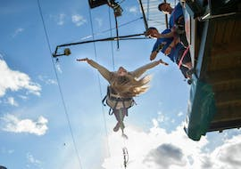 A participant of the  Canyon Swing in Queenstown is jumping off the platform under the watchful eyes of the experienced Shotover Canyon Swing & Fox Queenstown staff.