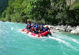 During their Rafting on the Lech River - Full Day Tour with BBQ Lunch with Fun Rafting Lechtal, a group of friends is having a great time while paddling along the turquoise Lech river.