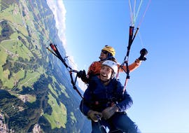 A young man and his tandem pilot from TirolAir are paragliding from the Hohe Salve.