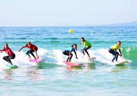 The participants of the Surfing Lessons at Playa de Patos for All Levels & Ages organized by Prado Surf Patos give their best in the water.