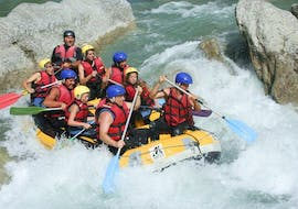 A group of friends is crossing rapids during their Rafting on the Verdon River - Discovery Tour with Azur Canoë Kayak Rafting.