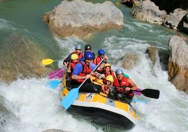 A group of friends is crossing rapids during their Rafting on the Verdon River - Classic Tour with Azur Canoë Kayak Rafting.
