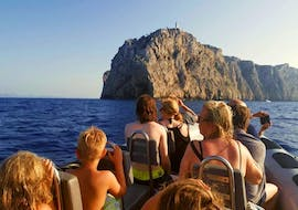The tour participants marvel at the big rock in the sea during the Private Boat Trip in Mallorca with Snorkeling with Alcúdia Sea Explorer.