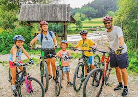 A family with 3 children is getting ready for a tour on their rented mountain bikes from Funpark Menina in Savinja Valley.