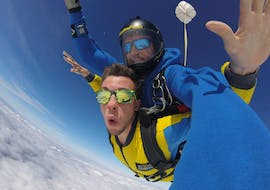 A tandem master from Skydive Porto and his student are pictured during their free fall as they go tandem skydiving in Porto.