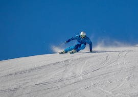 A skier is practicing on the slopes during his Private Ski Lessons for Adults in ACT Sports ski school in Arosa.