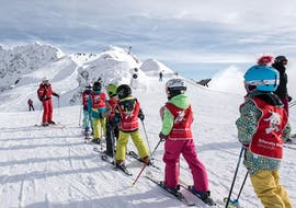 A group of children learn the basic techniques of skiing together with a ski instructor from the Ski School St.Gallenkirch during the Kids Ski Lessons (5-17 y.) for Beginners.