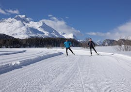 Two cross-country skiers glide through the fresh tracks during the Private Cross Country Skiing Lessons for All Levels of the Ski School St.Gallenkirch.