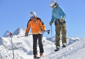 A ski instructor teaches his student the correct technique on the slopes during the Private Ski Lessons for Adults of All Levels of Ski School Ingrid Salvenmoser.
